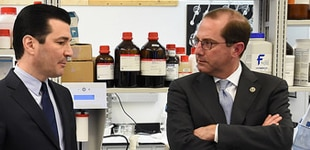 Alex Azar and another person standing in a lab