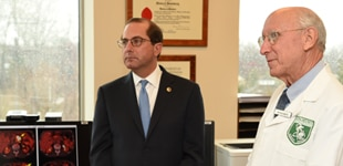 Alex Azar and person in doctor's jacket